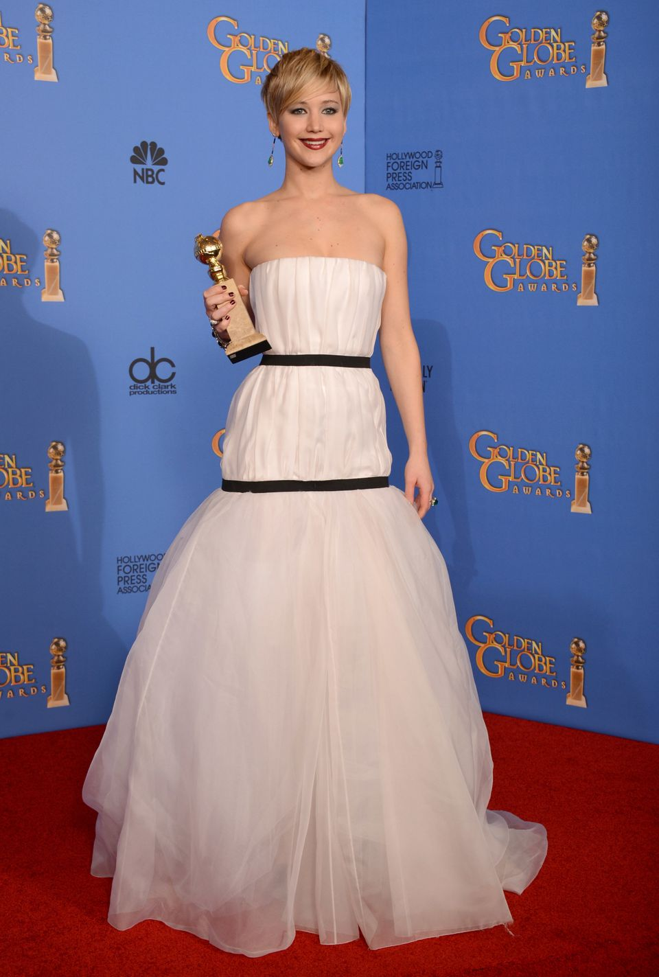 """Jennifer Lawrence poses in the press room with the award for best supporting actress for """"American Hustle"""" at the 71st annual"""
