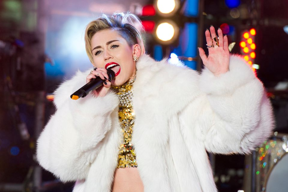 Miley Cyrus performs in Times Square during New Year's Eve celebrations on Tuesday, Dec. 31, 2013 in New York. (Photo by Char