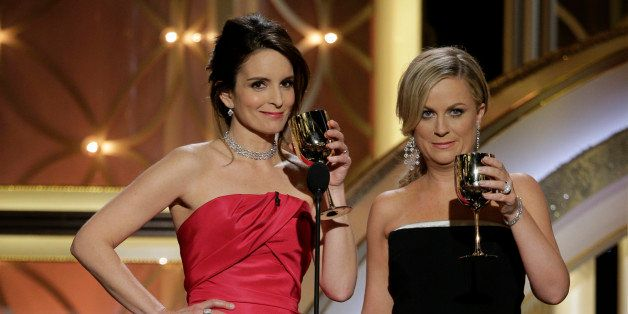 BEVERLY HILLS, CA - JANUARY 12:  In this handout photo provided by NBCUniversal,  Hosts Tina Fey and Amy Poehler speak onstag