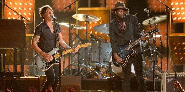 LOS ANGELES, CA - JANUARY 26:  Musicians Keith Urban (L) and Gary Clark Jr. perform onstage during the 56th GRAMMY Awards at