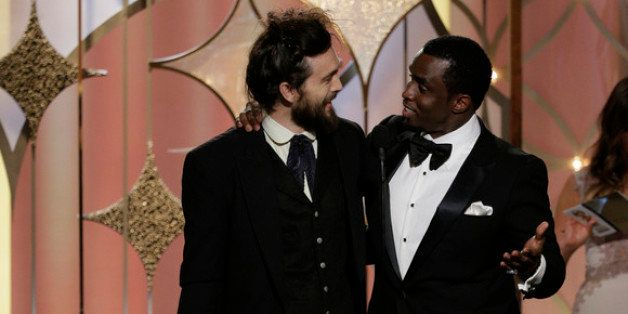 BEVERLY HILLS, CA - JANUARY 12:  In this handout photo provided by NBCUniversal,  Sean Diddy Combs presents Alex Ebert with t