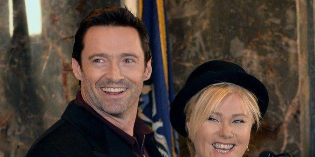 Hugh Jackman (C) and wife Deborra-lee Furness (R) before fliping a switch to ceremoniously light the Empire State Building li
