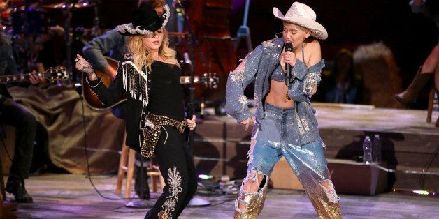 HOLLYWOOD, CA - JANUARY 28:  Recording artists Madonna (L) and Miley Cyrus perform onstage during Miley Cyrus: MTV Unplugged