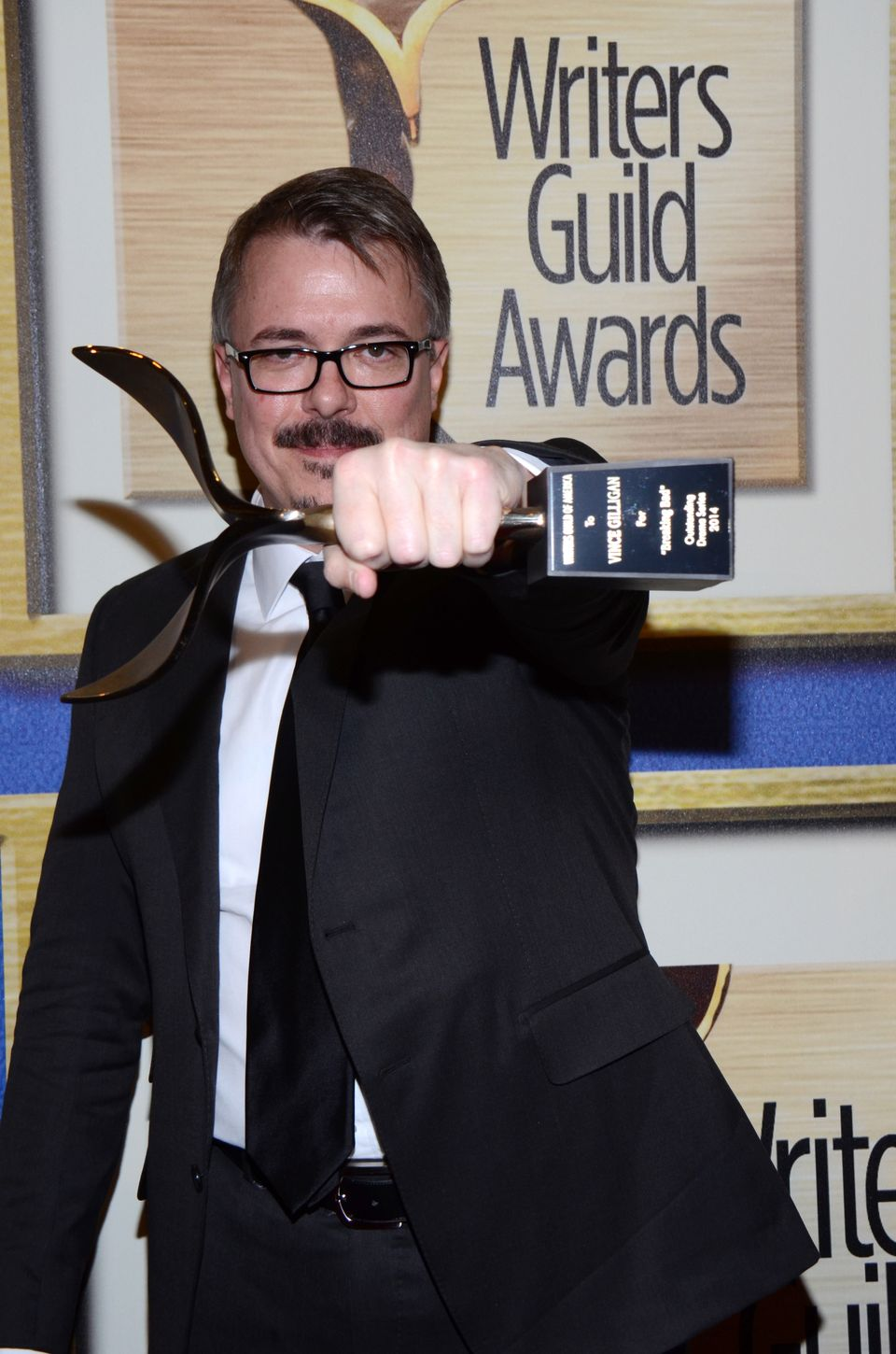 "Vince Gilligan poses in the press room with the Outstanding Drama Series award for ""Breaking Bad"" at the Writers Guild Awards"