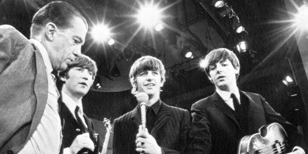 American TV host Ed Sullivan, left, talks with three members of the British pop group The Beatles during a rehearsal for thei