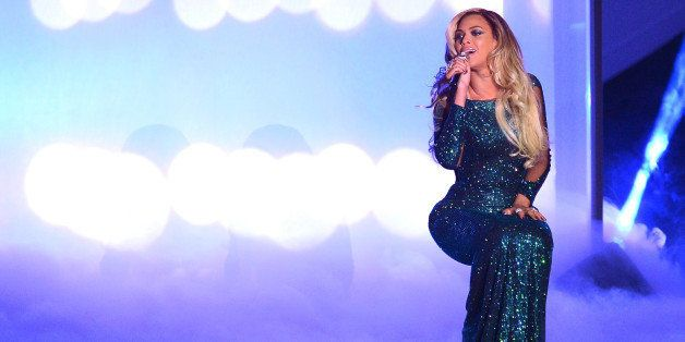 LONDON, ENGLAND - FEBRUARY 19:  Beyonce performs at The BRIT Awards 2014 at 02 Arena on February 19, 2014 in London, England.