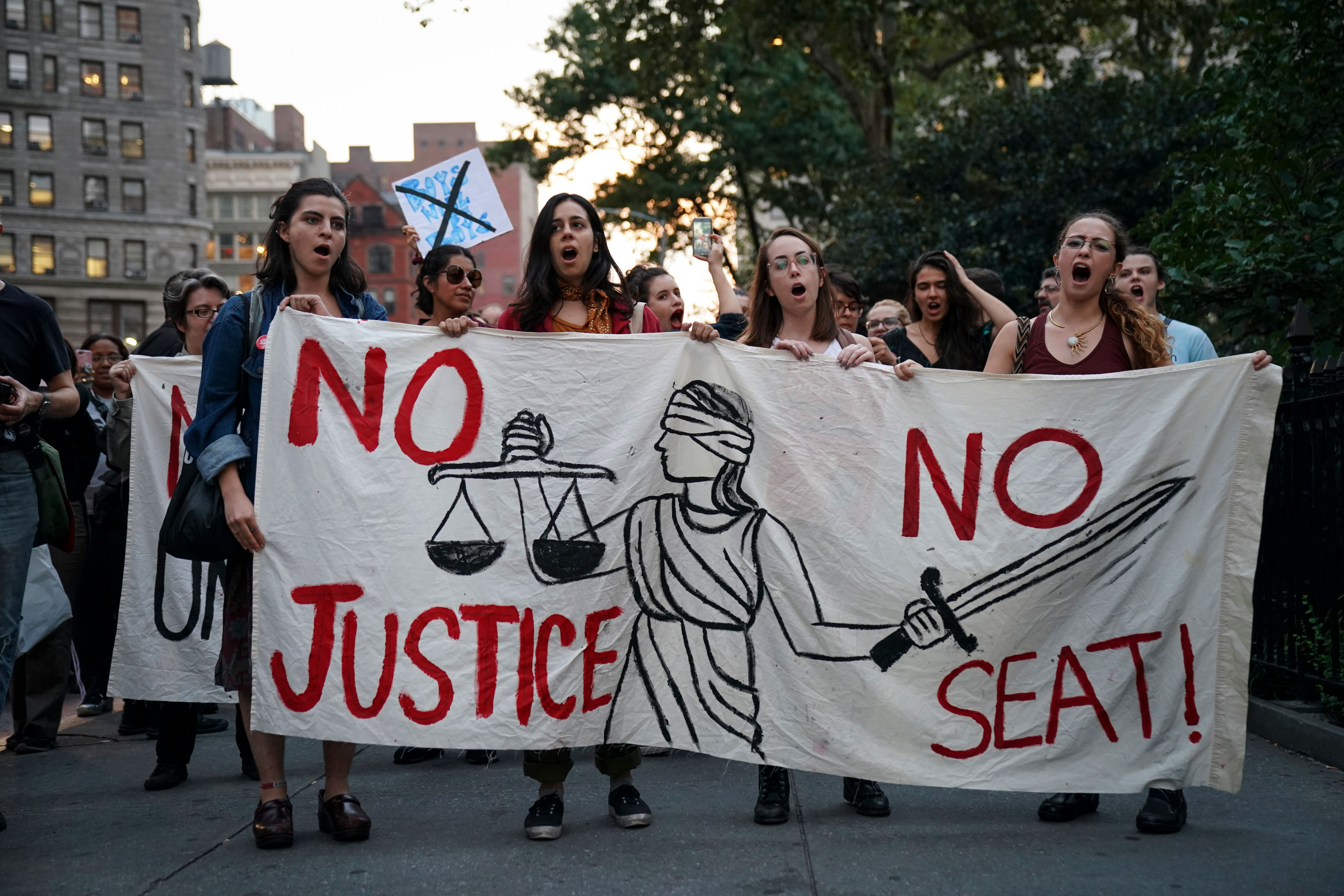 NEW YORK, NY - OCTOBER 1: Protestors rally against Supreme Court nominee Judge Brett Kavanaugh near Madison Square Park, October 1, 2018 in New York City. Following White House authorization, the FBI is further investigating sexual misconduct claims against Kavanaugh. In a speech on the Senate floor on Monday afternoon, Senate Majority Leader Mitch McConnell insisted he will hold a vote on Kavanaugh's confirmation later this week. (Photo by Drew Angerer/Getty Images)