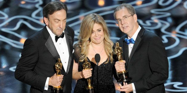 HOLLYWOOD, CA - MARCH 02:  (L-R) Producer Peter Del Vecho, directors Jennifer Lee and Chris Buck accept the Best Animated Fea