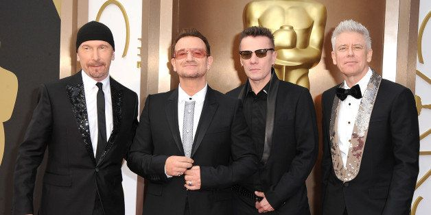 HOLLYWOOD, CA - MARCH 02:  U2 arrives at the 86th Annual Academy Awards at Hollywood & Highland Center on March 2, 2014 in Ho