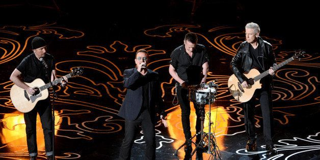 HOLLYWOOD, CA - MARCH 02:  (L-R) Musicians The Edge, Bono, Larry Mullen Jr., and Adam Clayton of U2 perform onstage during th