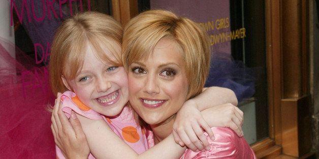 NEW YORK - AUGUST 7:  Actors Brittany Murphy (R) and Dakota Fanning help unveil the 'Uptown Girls' window display at Henri Be