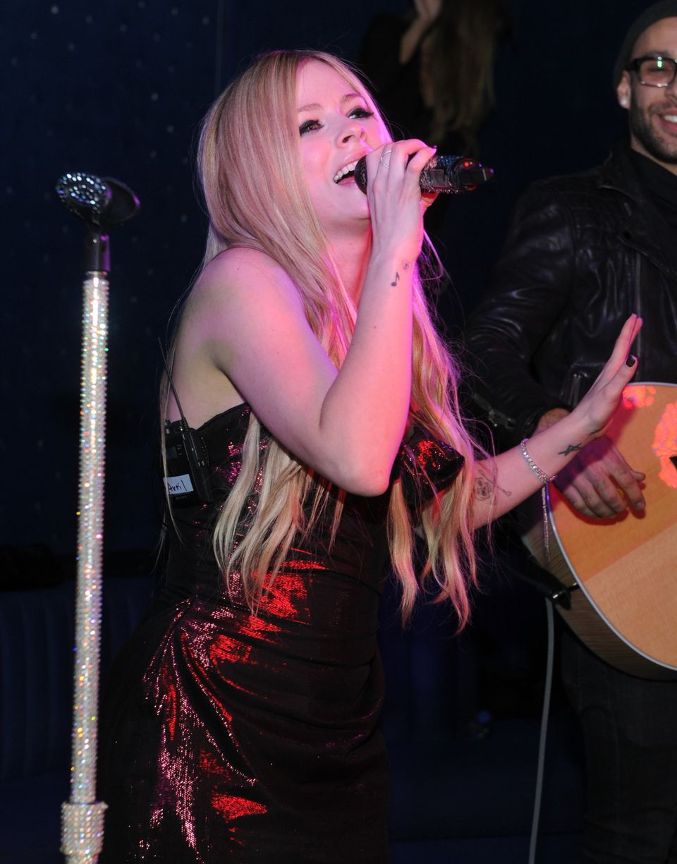 NEW YORK, NY - NOVEMBER 05:  Avril Lavigne performs at her new Album Release Party at the Finale on November 5, 2013 in New Y