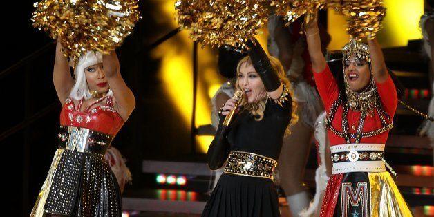 INDIANAPOLIS, IN - FEBRUARY 05:  Madonna, Nicki Minaj and M.I.A. perform during the Bridgesone Super Bowl XLVI Halftime Show