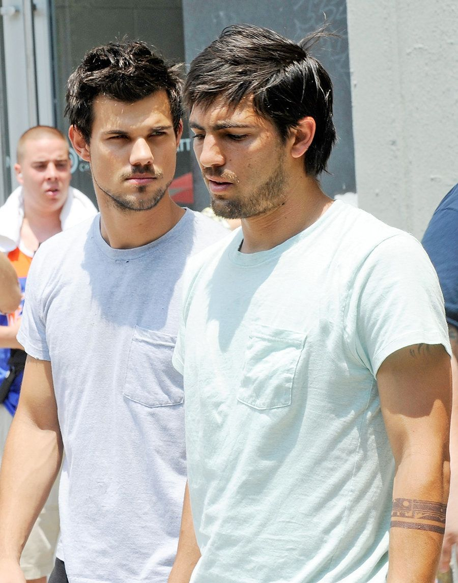 "Taylor Lautner with his stunt double on the set of ""Tracers"" on June 24, 2013 in New York City."