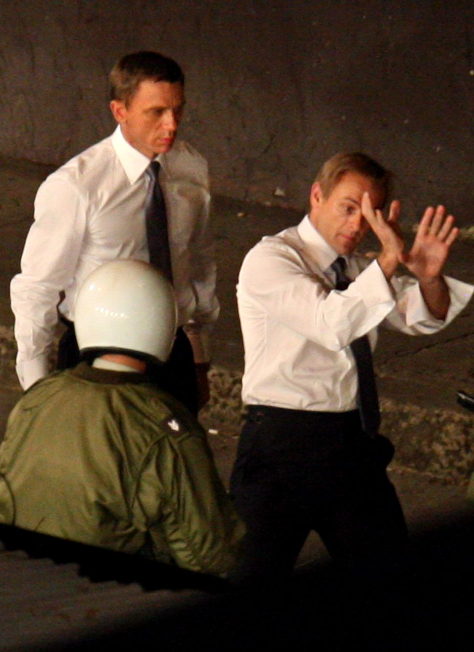 Daniel Craig watches intently as his stunt double went through a fight scene on location in Panama City, Panama during filmin