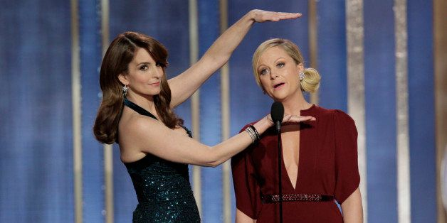 BEVERLY HILLS, CA - JANUARY 13: In this handout photo provided by NBCUniversal,  L to R Tina Fey and Amy Poehler host the 70t