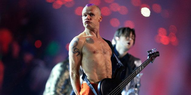EAST RUTHERFORD, NJ - FEBRUARY 02: Flea of the Red Hot Chili Peppers performs during the Pepsi Super Bowl XLVIII Halftime Sho