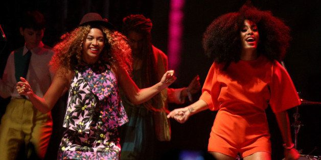 INDIO, CA - APRIL 12:  Singer Beyonce (L) performs with her sister Solange Knowles onstage during day 2 of the 2014 Coachella