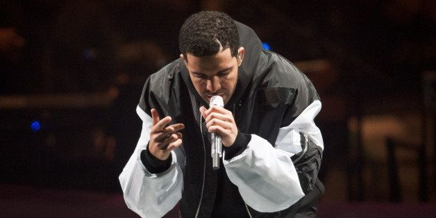 LONDON, UNITED KINGDOM - MARCH 24: Drake performs on stage at O2 Arena on March 24, 2014 in London, United Kingdom. (Photo by