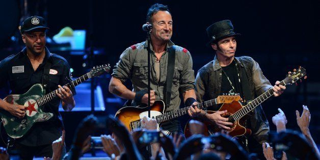 Bruce Springsteen, center, and members of the E Street Band perform at Time Warner Cable Arena in Charlotte, N.C., on Saturda