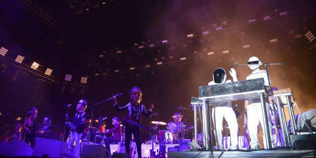 INDIO, CA - APRIL 20:  Daft Punk performs with Arcade Fire live onstage to close out the 2014 Coachella Valley Music And Arts