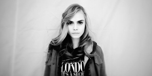 PARIS, FRANCE - FEBRUARY 27:  (Editors Note: This image was processed using digital filters) Model Cara Delevingne poses back