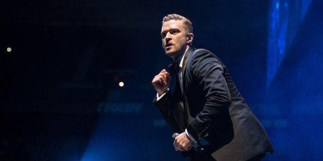 PARIS, FRANCE - APRIL 26: Justin Timberlake performs at Stade de France on April 26, 2014 in Paris, France. (Photo by David W