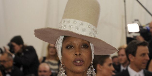 NEW YORK, NY - MAY 05:  Erykah Badu attends the 'Charles James: Beyond Fashion' Costume Institute Gala at the Metropolitan Mu