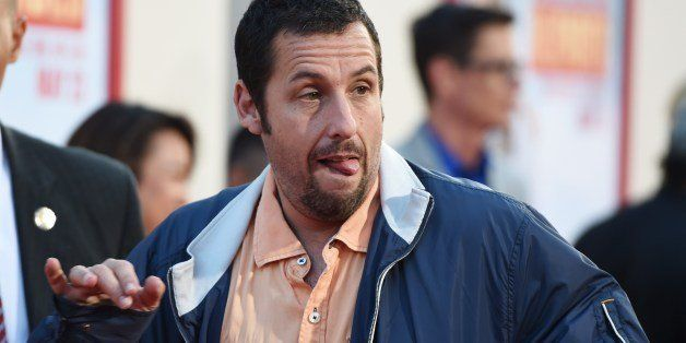 Actor Adam Sandler makes a silly face for photographers as he arrives for the red carpet premiere of 'Blended,' May 21, 2014