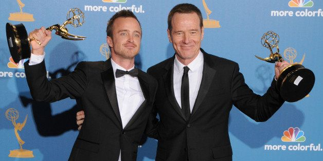 LOS ANGELES, CA - AUGUST 29: Bryan Cranston (L) and Aaron Paul pose in the press room with their awards for 'Outstanding Lead