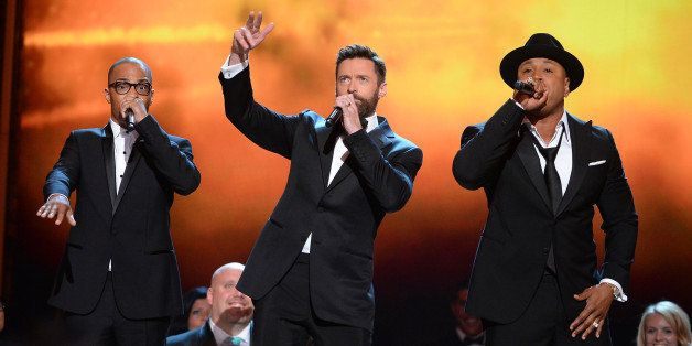 NEW YORK, NY - JUNE 08:  T.I., Hugh Jackman and LL Cool J performs onstage during the 68th Annual Tony Awards at Radio City M