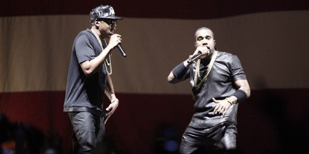 US rappers Kanye West and Jay-Z (L) perform during a concert as part of their tour 'Watch the Throne' on June 1, 2012 in Pari