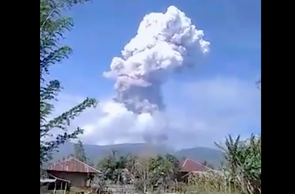 A volcano erupted Wednesday on the same central Indonesian island as an earlier earthquake and authorities warned planes about volcanic ash in the air