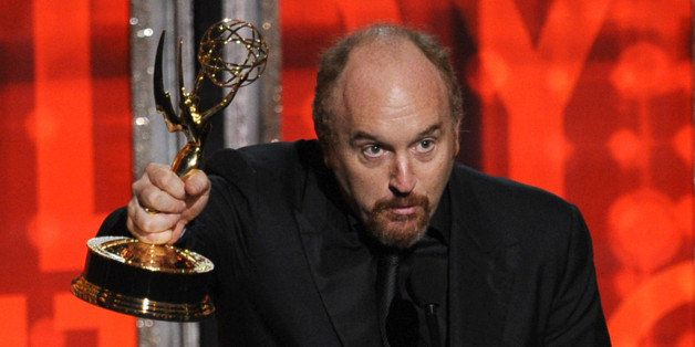LOS ANGELES, CA - SEPTEMBER 23:  Actor/writer Louis CK accepts Outstanding Writing for a Comedy Series award for 'Louie' onst