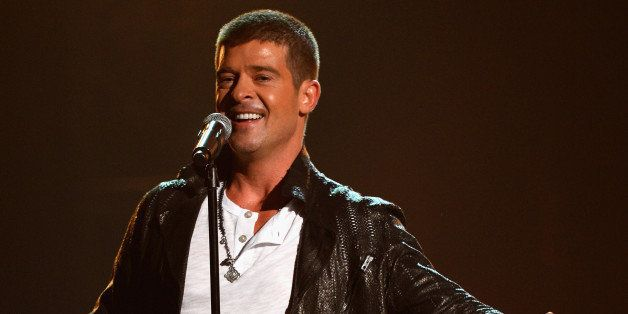 LAS VEGAS, NV - MAY 18:  Singer Robin Thicke performs onstage during the 2014 Billboard Music Awards at the MGM Grand Garden
