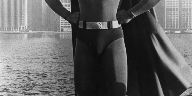 24-year-old American film actor Christopher Reeve stands before the Manhattan skyline dressed as the comic-book hero of the f