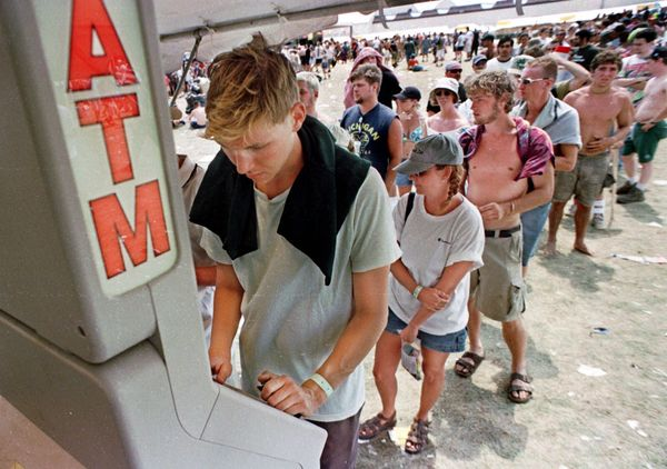 Hundreds stand in line for hours to access ATMs.