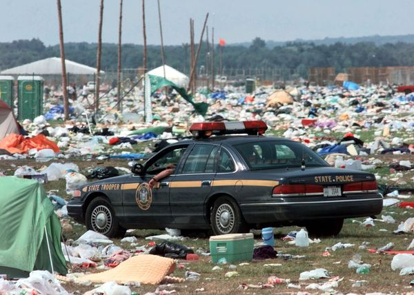 A New York State Police cruiser navigates through the debris at the campground.