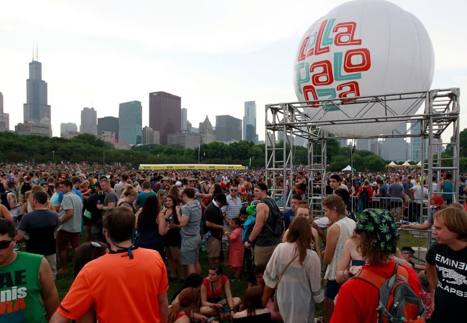 People wait for the band Chvrches to take the stage during Lollapalooza on Friday, Aug. 1, 2014, in Chicago. Once the vagabon