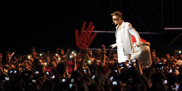 Canadian pop singer Justin Bieber performs during his concert in the Nacional Stadium, in Santiago, on November 12, 2013. AFP