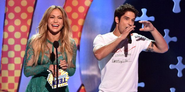LOS ANGELES, CA - AUGUST 10:  Recording artist Jennifer Lopez (L) and actor Tyler Posey onstage during FOX's 2014 Teen Choice