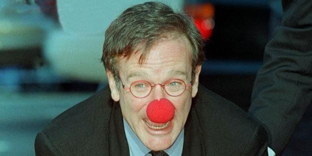 HOLLYWOOD, :  Academy Award-winning actor Robin Williams wears a clown nose as he places his hands in cement during his hand