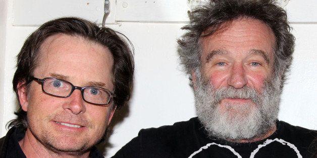 NEW YORK, NY - APRIL 09:  Michael J. Fox and Robin Williams pose backstage at the hit play 'Bengal Tiger at the Baghdad Zoo'