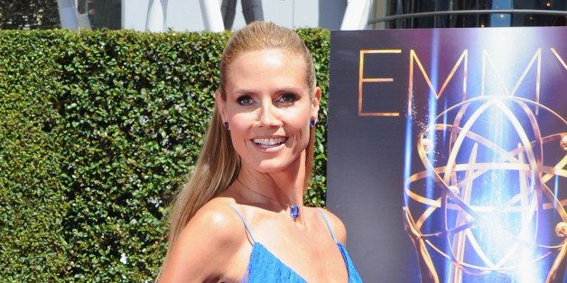 LOS ANGELES, CA - AUGUST 16:  Heidi Klum arrives at the 2014 Creative Arts Emmy Awards at Nokia Theatre L.A. Live on August 1