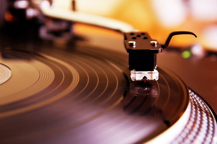 record player spinning the disc ...