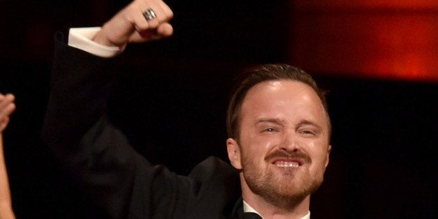 LOS ANGELES, CA - AUGUST 25:  Actor Aaron Paul celebrates co-star Bryan Cranston winning Outstanding Lead Actor in a Drama Se