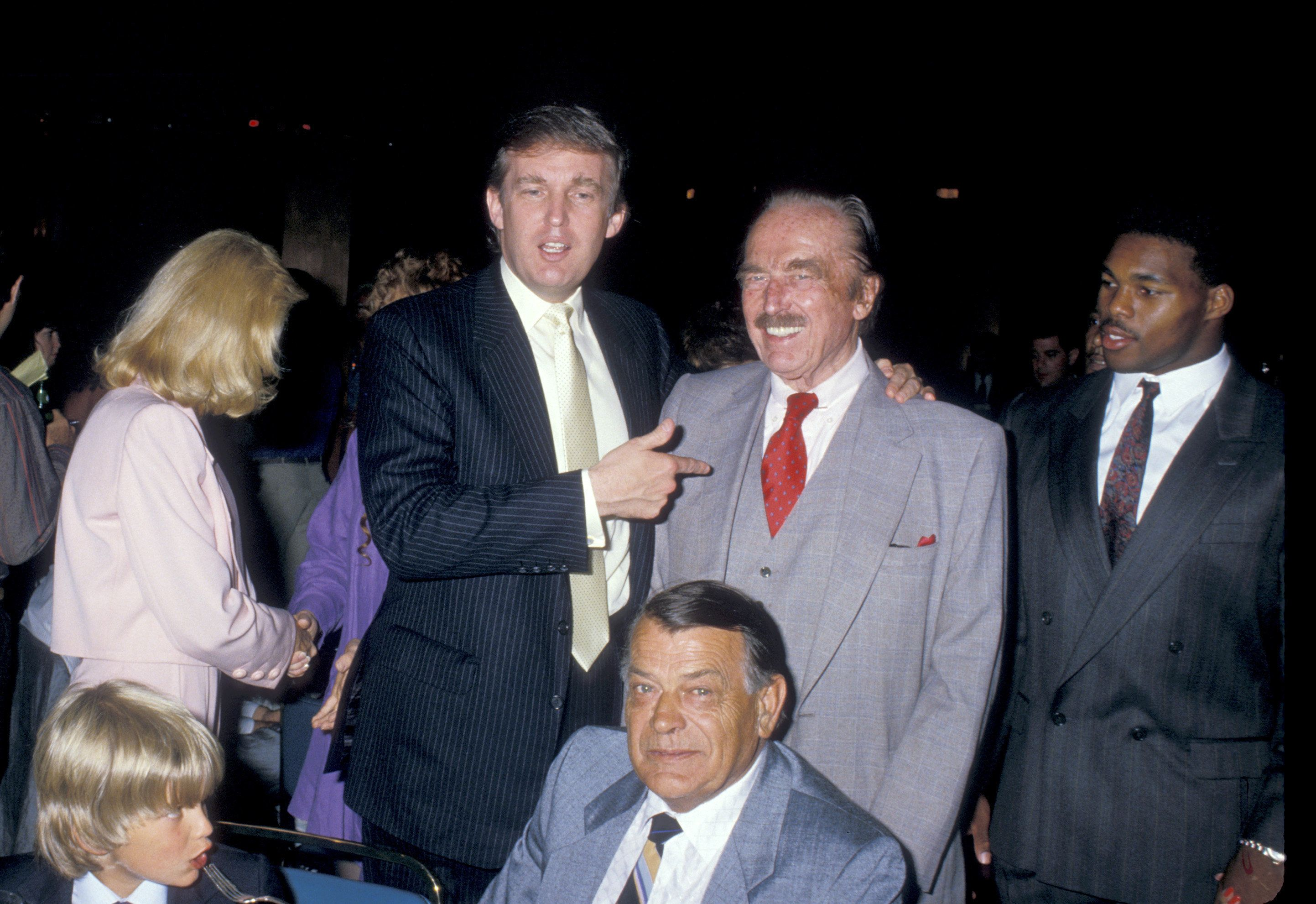 In this undated photo, Donald Trump (left) poses with his father, Fred Trump. According to a bombshell New York Times report,