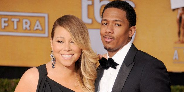 LOS ANGELES, CA - JANUARY 18: Singer Mariah Carey and actor/TV personality Nick Cannon arrive at the 20th Annual Screen Actors Guild Awards at The Shrine Auditorium on January 18, 2014 in Los Angeles, California. (Photo by Gregg DeGuire/WireImage)