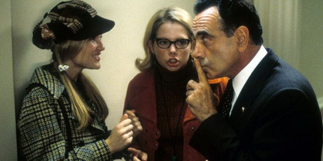 Kirsten Dunst, Michelle Williams and Dan Hedaya in a scene from the film 'Dick', 1999. (Photo by Phoenix Pictures/Getty Image