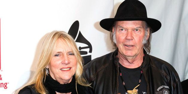 LOS ANGELES, CA - JANUARY 21:  Singer/songwriter Pegi Young (L) and musician Neil Young attend The Recording Academy Producer